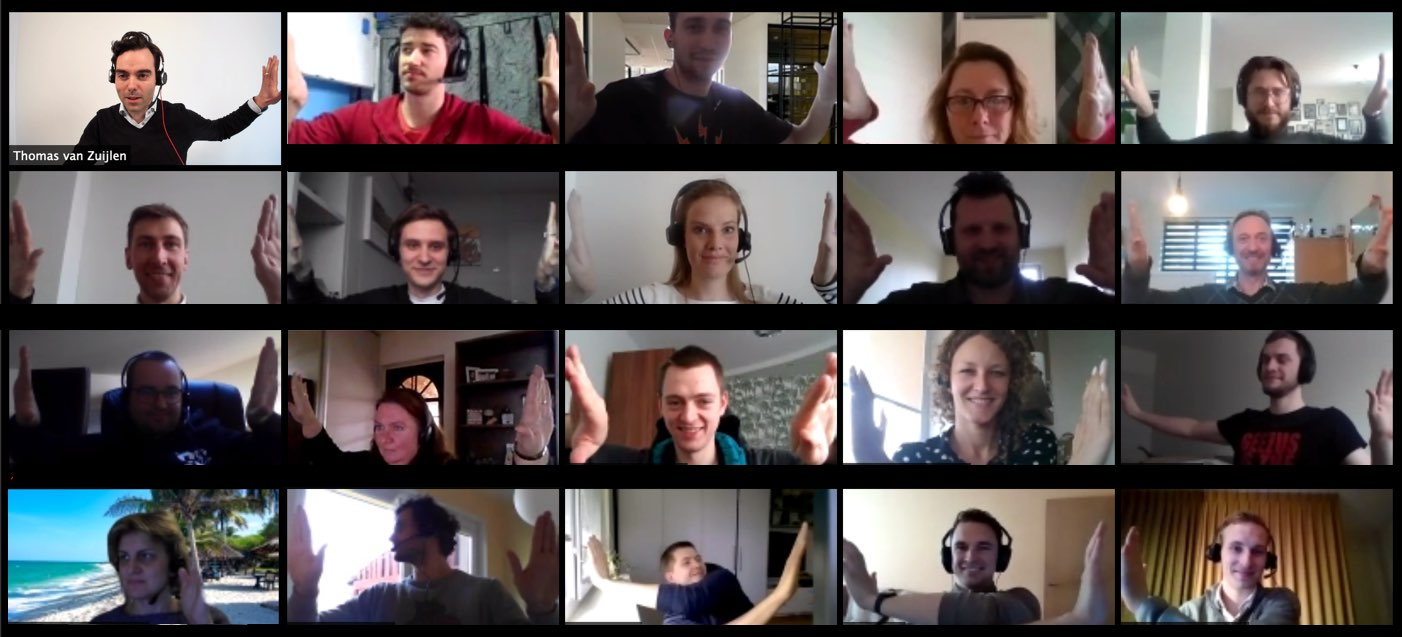 People in a video call joining hands for the camera